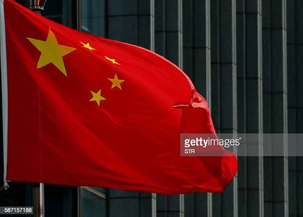 The Chinese national flag is seen on a flagpole in Beijing on August 8 2016 Most of the five stars on the Chinese flags being used at medal...