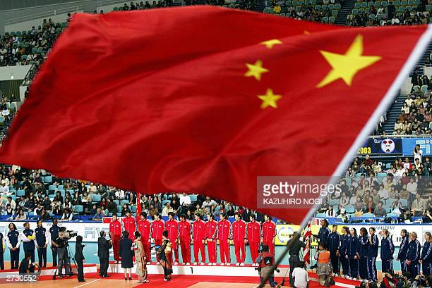 The Chinese national flag is waved during the awards ceremony for the winners at the World Cup women's volleyball tournament at the Namihaya Dome in...