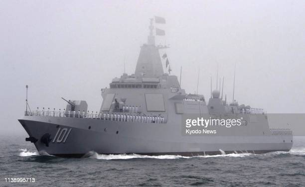 The Chinese navy unveils the upgraded version of the Type 055 destroyer off Qingdao, eastern China, on April 23 during a fleet review marking the...