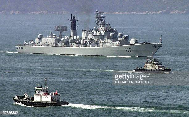 The Chinese People's Liberation Army Navy guided missile destroyer Harbin is escorted into Hong Kong early 30 April 2004 part of a Task Force...