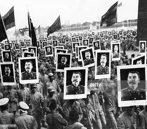 The Chinese People's Republic celebrating its first anniversary November 1950 Many of the 500000 participants in the demonstration are holding...