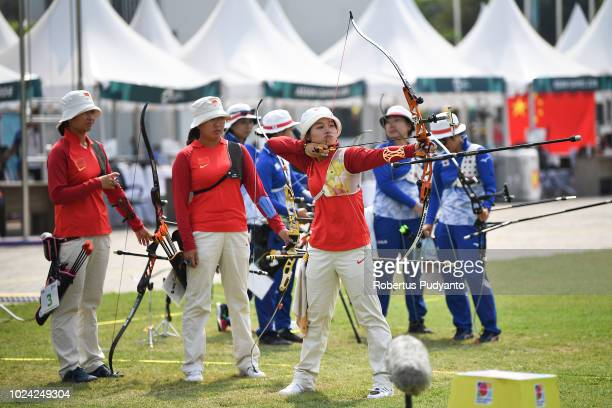 The Chinese team of Hui Cao Yuejun Zhai and Xinyan Zhang prepare during Recurve Women's Team Archery Final Rounds on day nine of the Asian Games on...