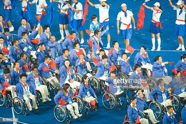 The Chinese team wave to the crowd during the Opening Ceremony for the 2008 Paralympic Games at the National Stadium on September 6 2008 in Beijing...