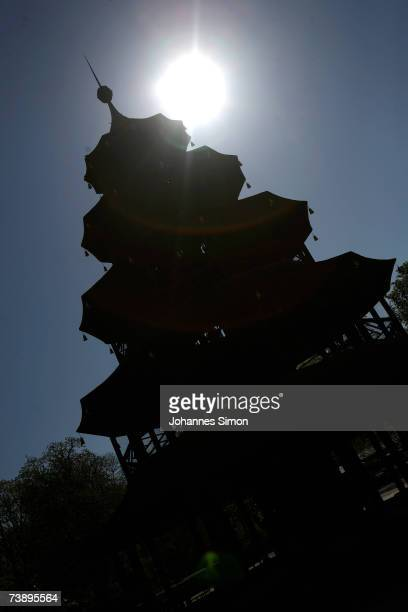 The Chinese Tower is silhouetted against the sun in the world famous Englischer Garten on April 16 in Munich Germany The unseasonably warm weather...