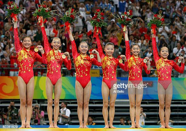 The Chinese women's gymnastics team celebrates after winning the gold in the artistic gymnastics team event at the National Indoor Stadium during Day...