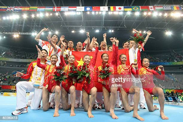 The Chinese women's gymnastics team celebrates after winning the artistic gymnastics team event at the National Indoor Stadium during Day 5 of the...