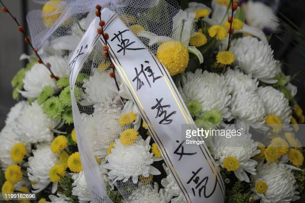 The Chinese wording on a ribbon saying Li's a hero in honour of Dr Li Wenliang at Li's hospital in Wuhan on February 072020 in WuhanHubei...