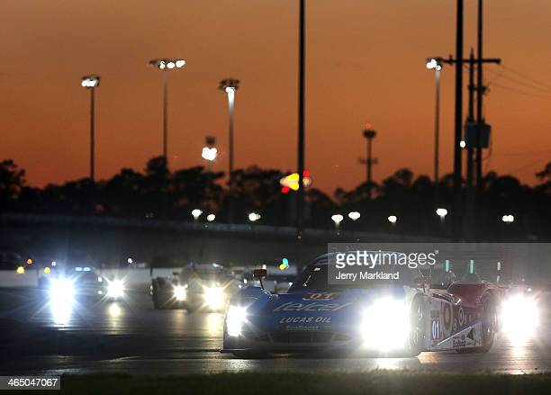 The Chip Ganassi Racing Telcel/Target Riley DP driven by Scott Pruett, Memo Rojas, Jamie McMurray and Sage Karam races during the night at the ROLEX...