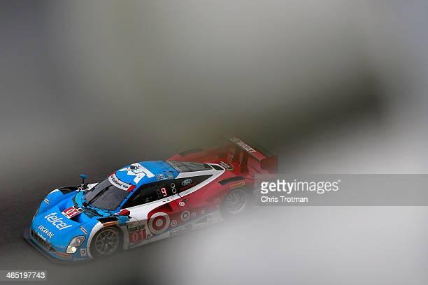 The Chip Ganassi Racing Telcel/Target Riley DP driven by Scott Pruett, Memo Rojas, Jamie McMurray and Sage Karem races during the Rolex 24 at Daytona...