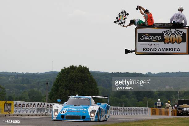 The Chip Ganassi Racing with Felix Sabates BMW Riley driven by Scott Pruett and Memo Rojas crosses the finish line to win the Rolex 250 Driven by...