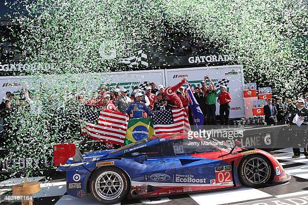 The Chip Ganassi Racing with Felix Sabates Target/Ford EcoBoost Riley driven by Scott Dixon, Tony Kanaan, Kyle Larson and Jamie McMurray celebrates...