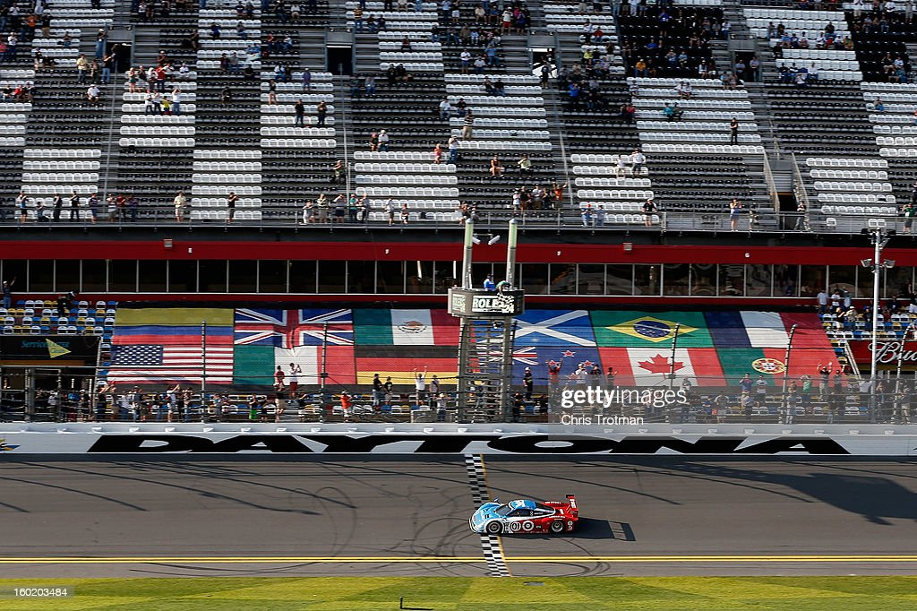 The #01 Chip Ganassi Racing with Felix Sabates TELMEX/Target Ford BMW Riley driven by Scott Pruett, Memo Rojas, Juan Pablo Montoya, Charlie Kimball and Scott Dixon, crosses the finish line to win the Rolex 24 at Daytona International Speedway on January 27, 2013 in Daytona Beach, Florida.
