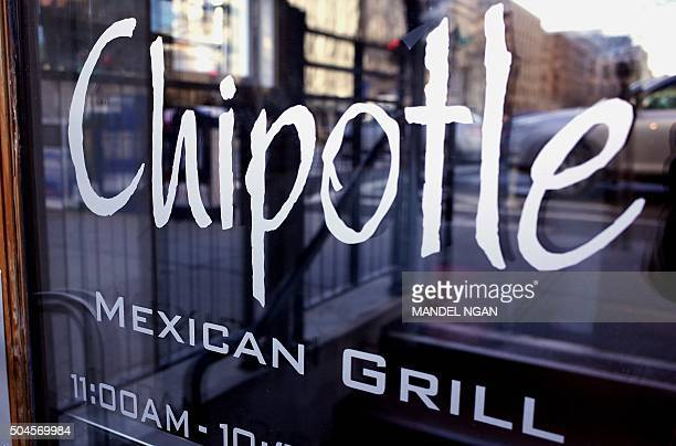 The Chipotle logo is seen on the door of one of its restaurants on January 11 2015 in Washington DC The embattled Mexican fast food chain is under...