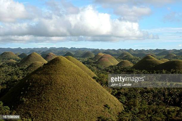 TAGBILARAN BOHOL PHILIPPINES The Chocolate Hills on Bohol are named after their chocolate dropshaped hills extending to the horizon The color of the...