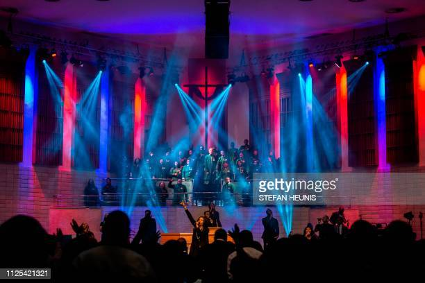 The choir of the House On The Rock church perform during a Sunday praise session in Lagos on February 17 2019 as religious leaders across Nigeria...