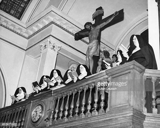 The Choir of the Sisters of Mercy sing during a religious service to celebrate the centenary of their control over various London Parish Schools