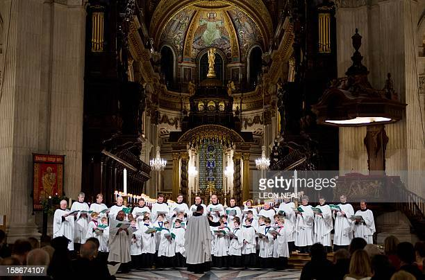 The choir perform from within the Dome sanctuary of St Paul's Cathedral in central London during the Christmas carol service on 23 December 2012 AFP...