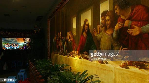 The choir sing beside a replica of Leonardo da Vinci's Last Supper during a performance to mark Christmas in Sheng Ai Tang Christian Church on...