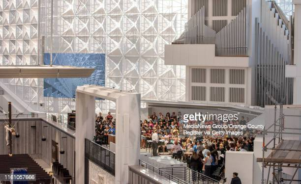 The Christ Cathedral Choir, right, rehearses at Christ Cathedral in Garden Grove on Monday, July 8, 2019 in preparation for the official dedication...