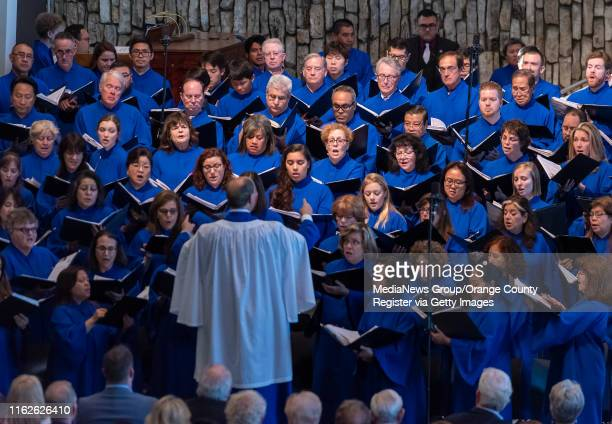 The Christ Cathedral Choir sings in the arboretum during the Solemn Evening Prayer and Vigil with the Relics at Christ Cathedral in Garden Grove on...