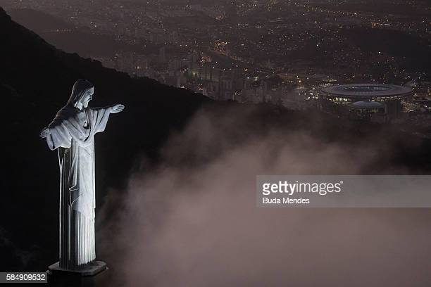 The Christ the Redeemer statue and Maracana Stadium are seen on July 31 2016 in Rio de Janeiro Brazil Rio 2016 will be the first Olympic Games in...
