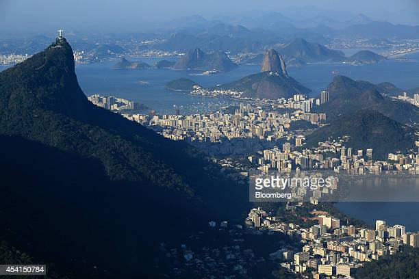 The Christ the Redeemer statue top left looks out over Guanabara Bay in this aerial photo taken in Rio de Janeiro Brazil on Friday Aug 22 2014...