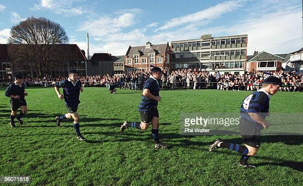 The Christchurch Boys High school 1st XV team run onto the field for their match against Christ's College played at Christ's College Christchurch...
