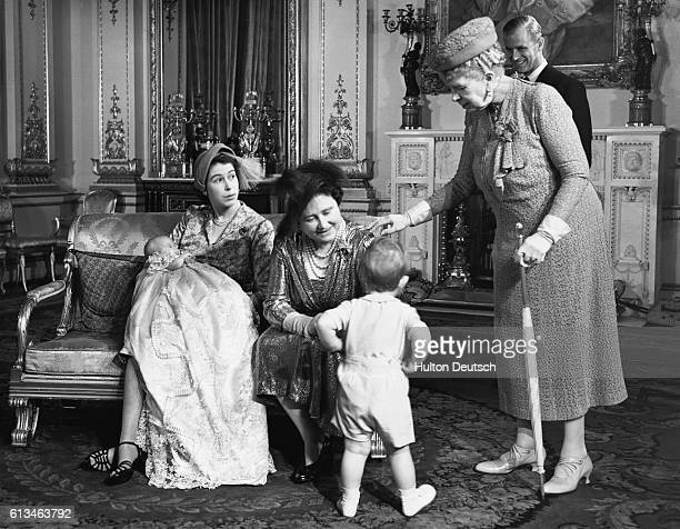 The christening of Princess Anne at Buckingham Palace Shown are Princess Elizabeth of York holding her daughter Princess Anne Queen Elizabeth the...