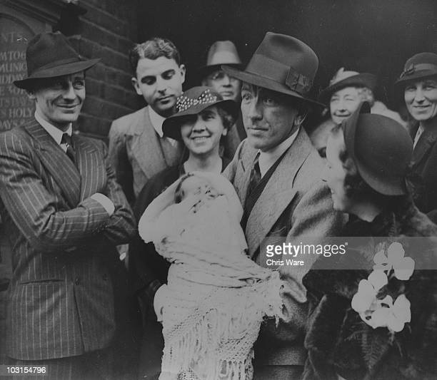 The christening of Welsh playwright and actor Emlyn Williams' son Alan at Chelsea Old Church in London 3rd October 1935 From left to right actor and...