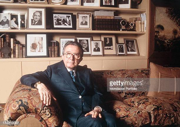 The Christian Democracy party senator Giulio Andreotti is seated on a sofa Behind him a bookshelf and many photograph cases Italy 1993