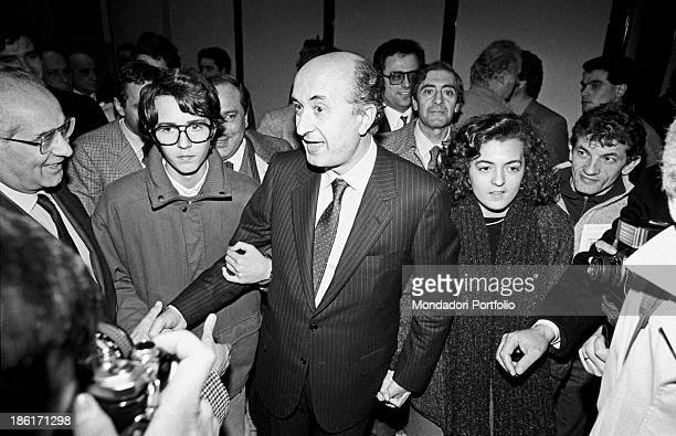 The Christian Democracy's Secretary General Ciriaco De Mita accompanied by his children Giuseppe and Antonia who hold his hands is greeted by a big...