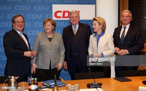 The Christian Democratic Union party's state leader in North RhineWestphalia Armin Laschet German chancellor Angela Merkel State Premier of Hessen...