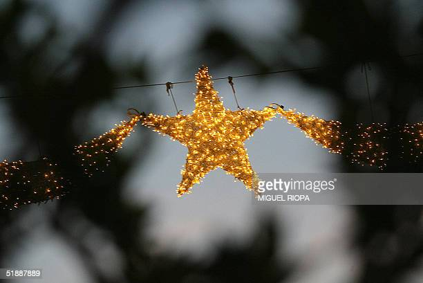 The christmas lights hung in a central street of Vigo northwestern Spain 22 December 2004 AFP PHOTO/ Miguel RIOPA