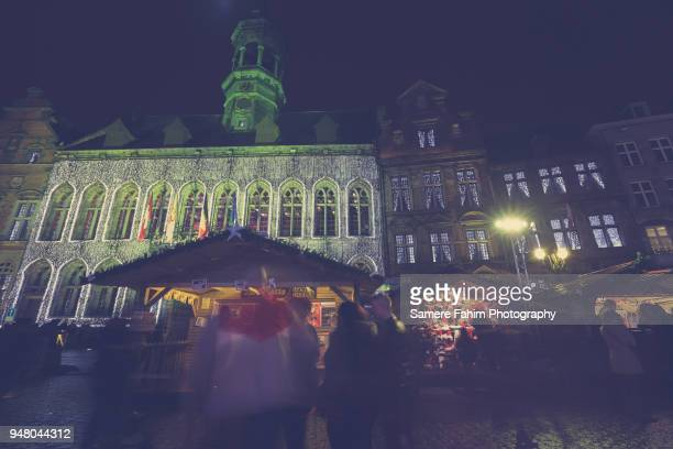 the christmas market and mons town hall at night - samere fahim stock photos and pictures