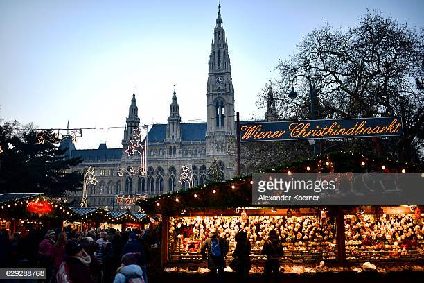 The christmas market at the town hall of Vienna is seen during sunset on December 5 2016 in Vienna Austria The town of Vienna is the federal capital...