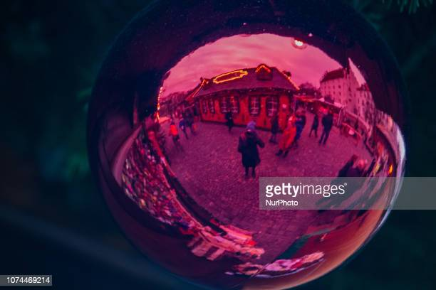 The Christmas Market being reflected in a christmas tree ball Christmas Market in Ingolstadt known for producing Audi