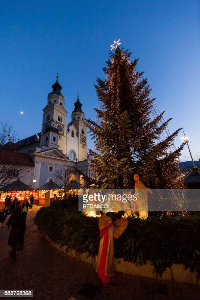 The Christmas Market in Brixen on the medieval market place Europe the steeples of Brixen cathedral in the background Europe Central Europe Italy...