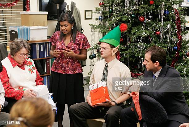 THE OFFICE 'The Christmas Party' Episode 10 Aired Pictured Phyllis Smith as Phyllis Lapin Mindy Kaling as Kelly Kapoor Rainn Wilson as Dwight Schrute...