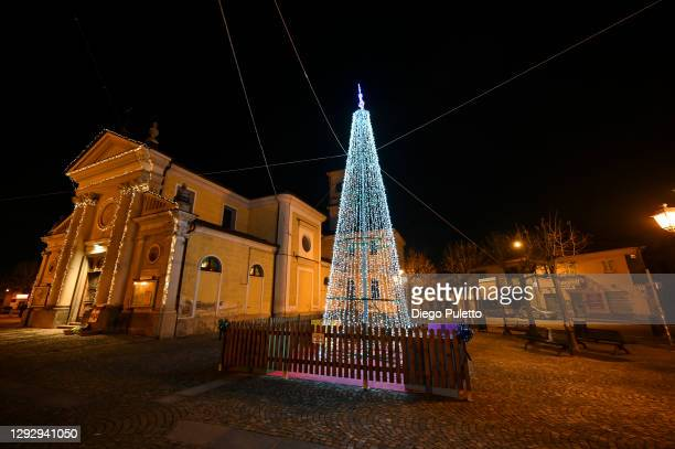The Christmas tree in Piazza Candiolo is seen on December 24, 2020 in Turin, Italy. Due to the coronavirus pandemic Christmas religious services have...