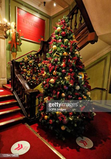 The Christmas tree inside the foyer to Piccadilly Department store. Piccadilly Department store Fortnum & Mason is famous worldwide and known as 'The...