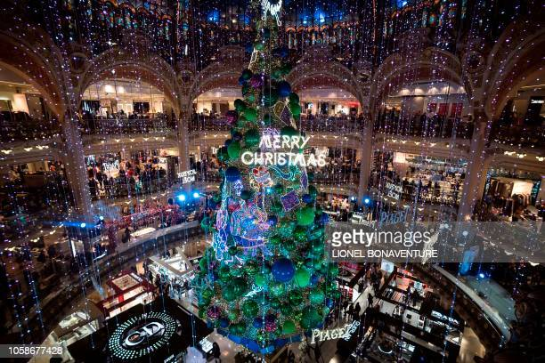 The Christmas tree inside the main hall of the Galeries Lafayette department store is pictured in Paris on November 7 2018