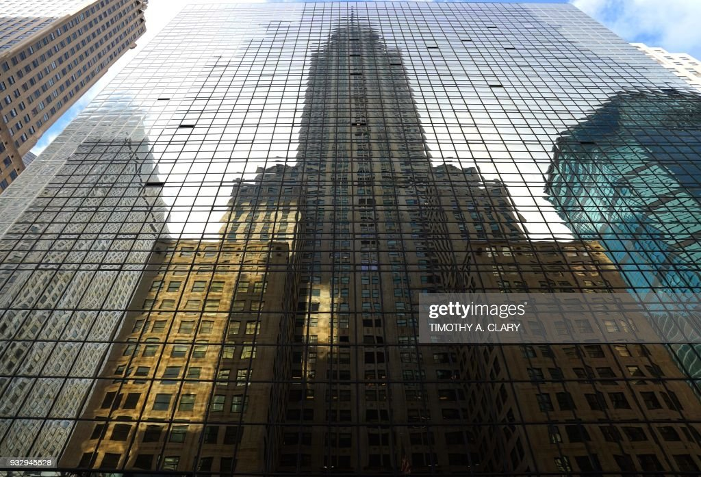 The Chrysler Building, an Art Deco-style skyscraper, is reflected on ...