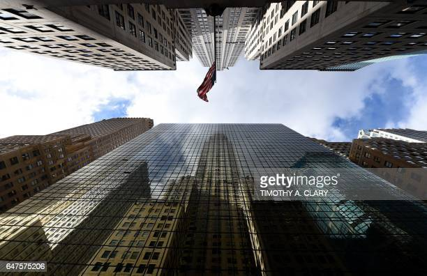 TOPSHOT The Chrysler Building is reflected in the side of the Grand Hyatt Hotel in midtown Manhattan on March 3 2017 Cold air is still in the area...