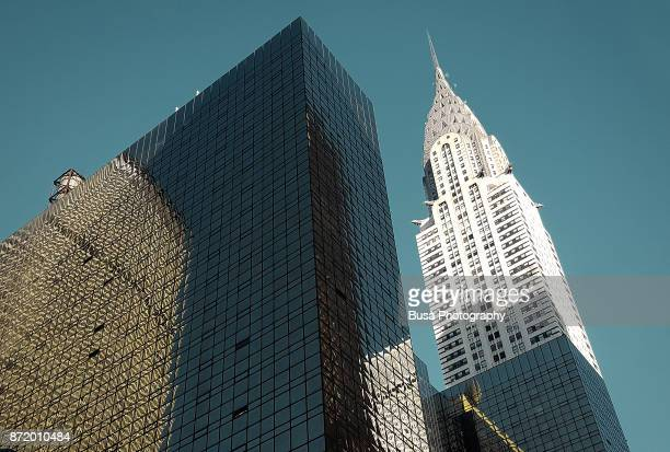 the chrysler building on the east side of midtown manhattan in new york city, at the intersection of 42nd street and lexington avenue. new york city, usa - international landmark stock pictures, royalty-free photos & images