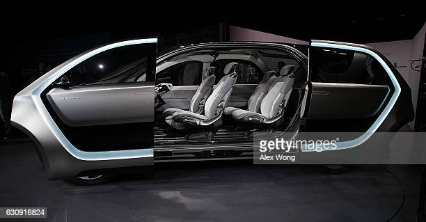 The Chrysler Portal an electricpowered concept minivan focused toward the millennial generation is seen with its sidedoors opened during a press...