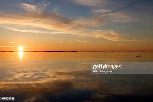 The Chukchi Sea lies flat under the soft Arctic 3 am sunlight during the traditional Inupiat Eskimos spring hunt June 14 2005 on the Chukchi Sea near...