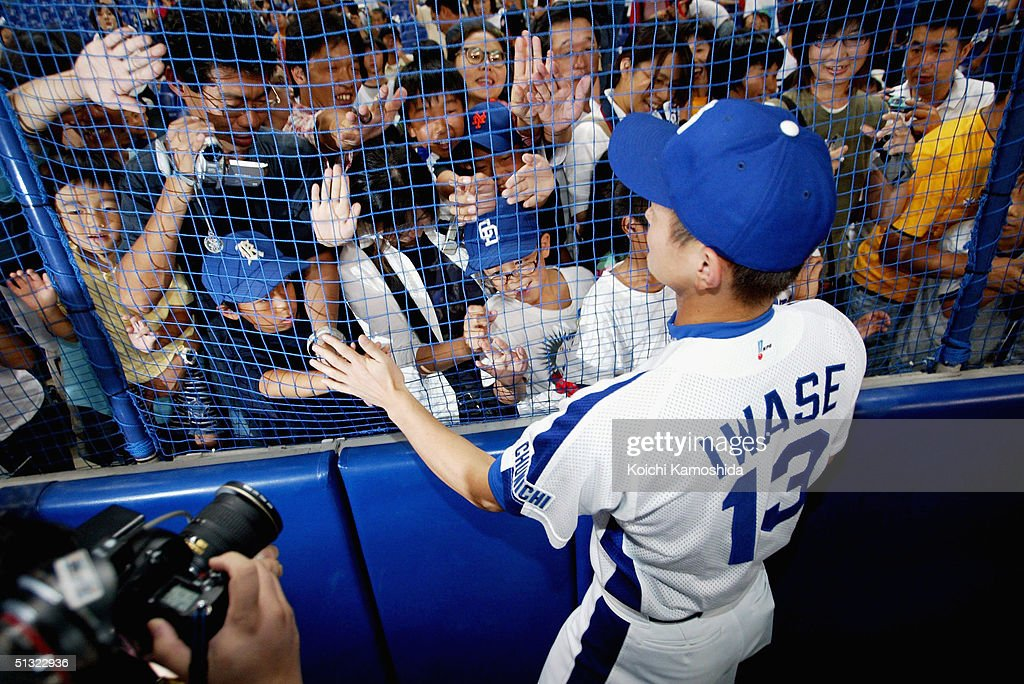 The Chunichi Dragons player Hitoki Iwase greets fans at Nagoya Dome, on September 19, 2004 in Nagoya, Japan.The Chunichi Dragons and the Yomiuri Giants scheduled games for Saturday and Sunday were cancelled due to a players' strike. The Japan Professional Baseball Players Association decided to go on first strike September 18 and 19. The front-running Chunichi Dragons, who are closing in on their first CL championship in five years, were scheduled to play the second-place Yomiuri Giants in a three-game series at Nagoya Dome beginning Saturday.