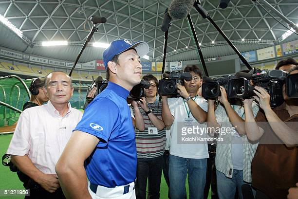The Chunichi Dragons player Kazuyoshi Tatsunami speaks to reporters in the Nagoya dome, where a Central League game between the Chunichi Dragons and...