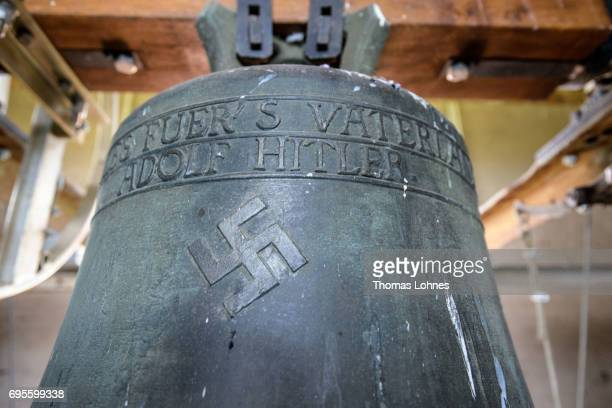 The church bell embossed with a swastika and the text 'Everything for the Fatherland Adolf Hitler' in the Jakobskirche village church pictured on...