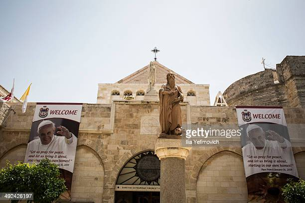 The Church of Nativity taking pictures with poster of Pope Francis in the background on May 20 2014 in Bethlehem West Bank Pope Francis is due to...
